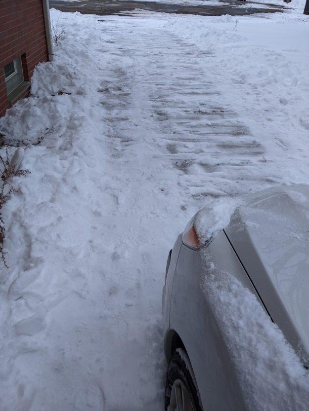 shoveled driveway, car ready to go
