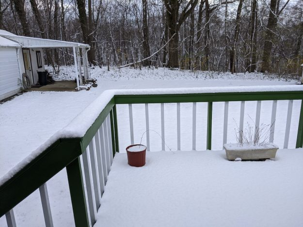 april snow on my deck and back yard