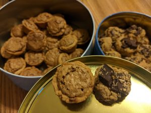 tins of homemade pecan tassies and peanut butter chocolate cookies
